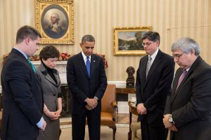 President Obama and staff share a minute of silence after the Newtown shootings.